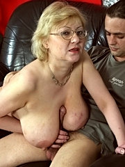 Mature blonde with big tits takes a cock from behind!