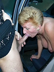 Horny mature slut sucking two cocks for the price of one