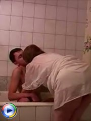 Young fucker gets caught in the bathroom and seduced to fuck a milf