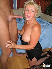 Busty mature blonde with massive ass riding a cock on the bed