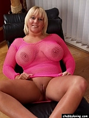 Busty blondie in pink bodysuit