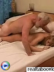 Experienced mature man giving his young girlfriend some oral pleasure