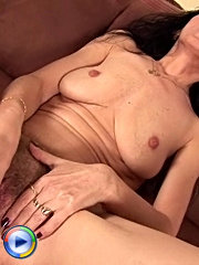 Hairy pussy mom masturbates on the couch