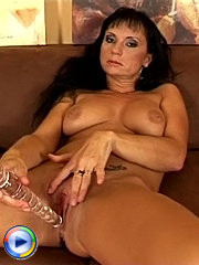 Milf on the couch spreads her legs open wide