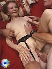 Horny granny getting on with two guys