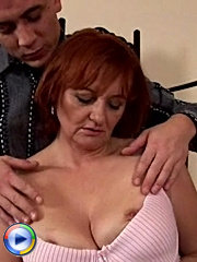 Redheaded mom gets fucked by young stud