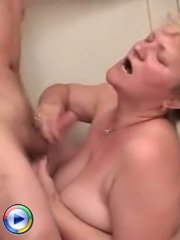 Busty fat mature bitch strokes a big dick and takes it inside her old pussy