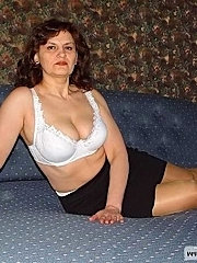 Mature businesswoman in hot striptease action