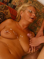 Younger stud shoots his load onto granny�s jugs