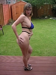 Big boobed milf flashing in the garden