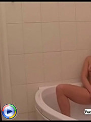Naughty guy spies on a blonde milf while she takes a bath and she notices him and invites him in