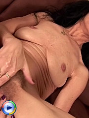 Mom with a hairy twat stuffs it with a dildo