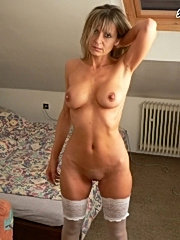 Hotny mature lesbians playing with a strap on cock