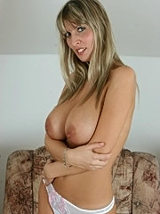 Busty milf milly shows off her huge boobs